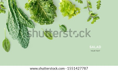 Creative layout made of kale, salad leaves, spinach, ruccola on green background. Flat lay. Food concept. Macro concept. #1551427787