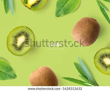 Creative layout made of kiwi and leaves. Flat lay. Food concept. Kiwi on green background. Zdjęcia stock ©