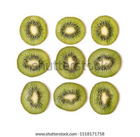 Creative layout made of kiwi slices. Flat lay, top view. Vegetables isolated on white background. Food ingredient pattern..