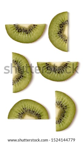 Creative layout made of kiwi slices. Flat lay, top view. Vegetables isolated on white background. Food ingredient pattern...
