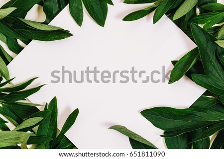 Creative layout made of leaves with white paper card note. Flat lay. Copy space for text. #651811090
