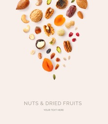 Creative layout made of macadamia, hazelnuts, walnut, cashew, sunflower seeds, peanut, almond, dates, pecan, fig, pumpkin seeds, pistachio, raisin,  cranberry on the beige background. Food concept.