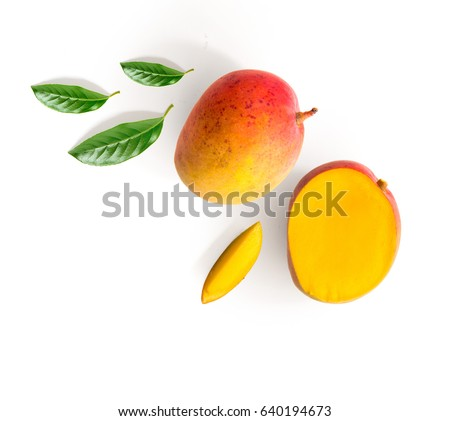 Creative layout made of mango and leaves. Flat lay. Food concept. Mango on white background.
