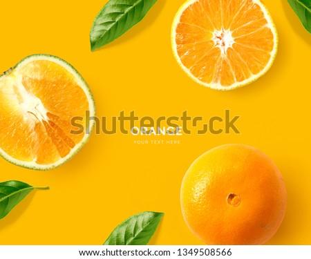 Creative layout made of orange. Flat lay. Food concept. Macro concept. Orange background. #1349508566