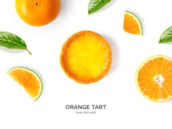 Creative layout made of orange tart on the white background. Flat lay. Food concept.