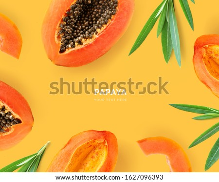 Creative layout made of papaya and leaves. Flat lay. Food concept. Papaya on yellow background. Stockfoto ©
