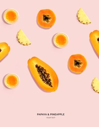Creative layout made of papaya, papaya juice and pineapple on pink background. Flat lay. Food concept. Macro  concept.