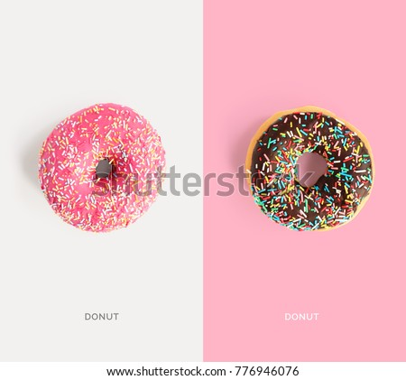Creative layout made of pink and chocolate donuts. Flat lay. Food concept. Macro  concept.