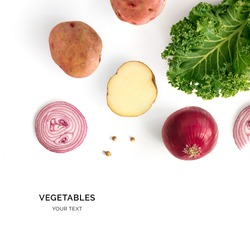Creative layout made of potatoes, onion and kale. Flat lay. Food concept. Vegetables isolated on white background.