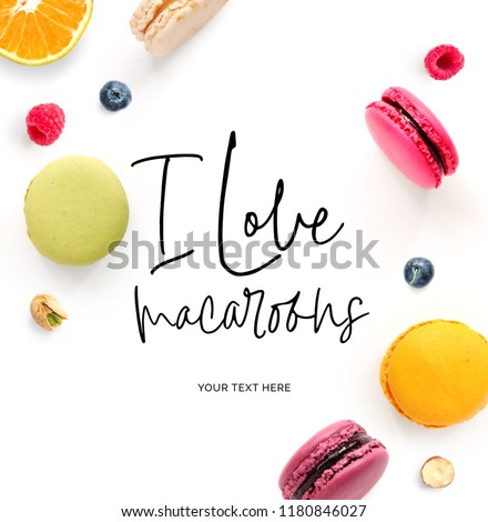 """Creative layout made of  quote """"I love macaroons"""". Food concept. Macaroons on white background."""