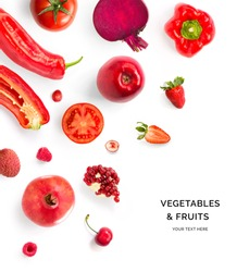 Creative layout made of red vegetables and fruits. Flat lay. Food concept. Tomato, red apple, pomegranate, red pepper, raspberry, strawberry, cherry,  beetroot and lychee on the white background.