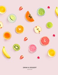 Creative layout made of smoothie, juice and fruits on pink background. Flat lay. Food concept. Macro  concept.