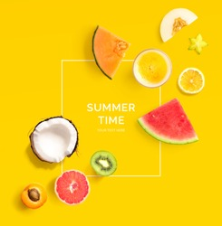 Creative layout made of summer fruits.  Tropical flat lay. Food concept. Melon, coconut, watermelon, kiwi, apricot, lemon and orange juice on yellow background.