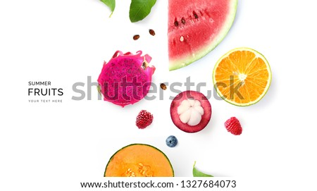 Creative layout made of summer fruits.  Tropical flat lay. Food concept. Melon, watermelon, mangosteen, dragonfruit and  loganberry on white background. #1327684073