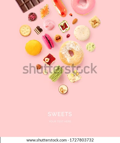 Creative layout made of sweets on pink background. Flat lay. Food concept.