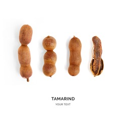 Creative layout made of tamarind. Flat lay. Food concept. Tamarind on the white background.