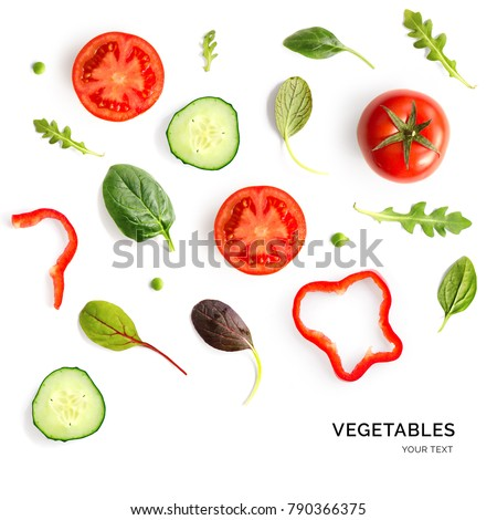 Creative layout made of tomato, cucumber and salad leaves. Flat lay. Food concept.