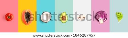 Creative layout made of tomato, papaya, coconut, avocado, champignon, cabbage and salad. Flat lay. Food concept. Macro  concept.