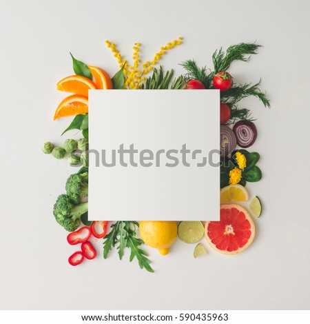 Creative layout made of various fruits and vegetables with white paper card. Flat lay. Food concept.