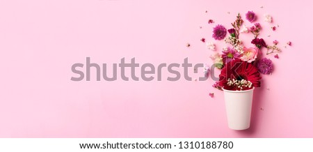 Creative layout made of white paper cup with pink flowers. Flat lay, top view. Banner with copy space. Valentines day, Woman day concept. Spring or summer banner with copy space. #1310188780