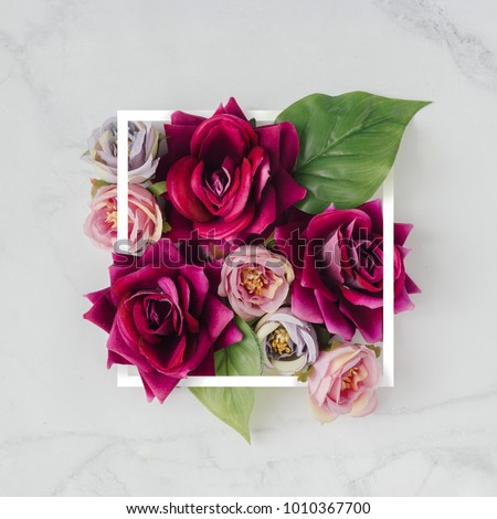 Creative layout made with flowers and white frame. Spring minimal concept. Nature background.