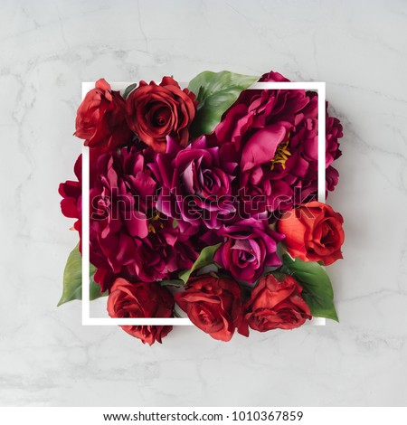 Creative layout made with flowers and white frame. Spring minimal concept. Nature background. #1010367859