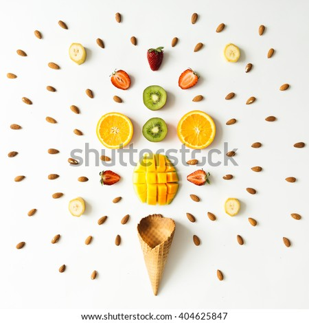 Creative layout of fresh fruits, nuts and ice cream cone. Flat lay. Summer concept.