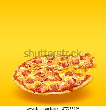 Creative layout of hot delicious pizza in flying on summer orange background. Pizza pepperoni design mockup flyer or poster for promotions and discounts with copy space. Fast Food concept. #1377288449