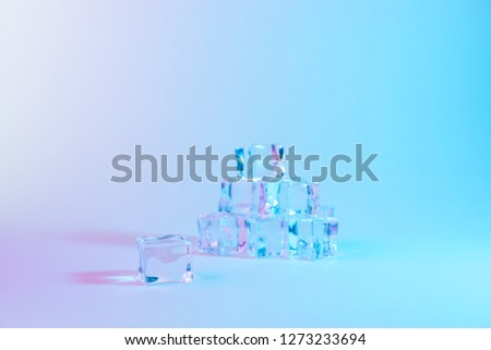Creative layout of ice cubes in vibrant bold gradient holographic colors. Concept art. Minimal surrealism.