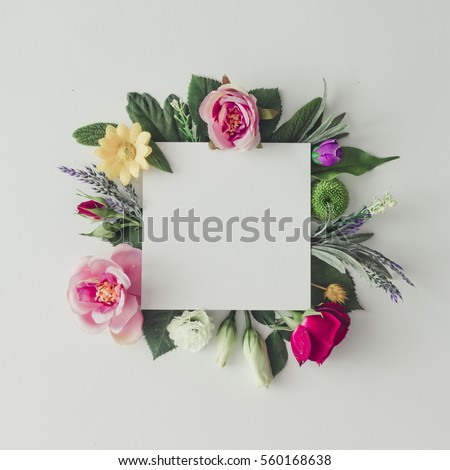 Creative layout with colorful flowers, leaves and copy space card note. Nature concept. Flat lay. #560168638