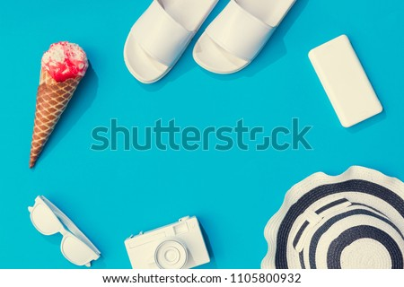 Creative layout with copy space and various summer objects on pastel blue background. Minimal vacation concept. Flat lay. #1105800932