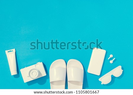 Creative layout with copy space and various summer objects on pastel blue background. Minimal vacation concept. Flat lay. #1105801667