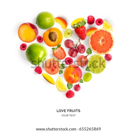 Creative layout with heart shape by various fruits. Heart of grape, apricot, raspberry, strawberry, lemon, apple, plum. Flat lay. #655265869
