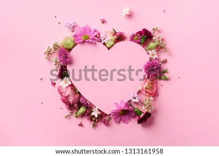 Creative layout with pink flowers, paper heart over punchy pastel background. Top view, flat lay. Spring, summer or garden concept. Present for Woman day. #1313161958