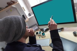 Creative man pointing at desktop screen with a digital  graphics pen.