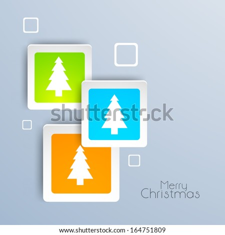 Creative Merry Christmas celebration sticker, tag or label decorated with Xmas trees on grey background.