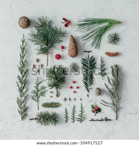 Creative natural layout made of winter things on marble background. Flat lay.
