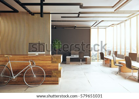Creative office interior with bicycle, reception desk, several desks with computer monitors and panoramic city view. 3D Rendering