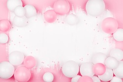 Creative painted background with white pink balloons and confetti. Top view and flat lay. Birthday or party concept.