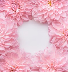 Creative pastel pink flowers frame, top view. Layout  or greeting card for Mothers day, wedding or happy event