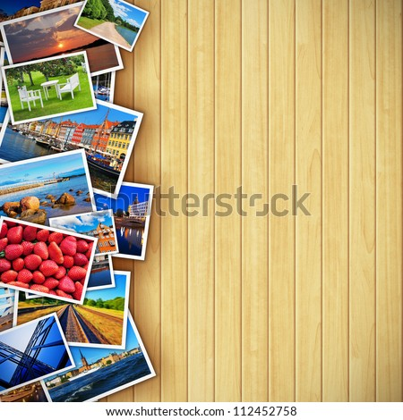 Creative photo gallery concept: collection of colorful photos on background made from wooden planks