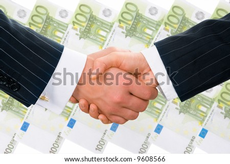 Creative photo of businesspeople handshake on the background of hundred euro banknotes