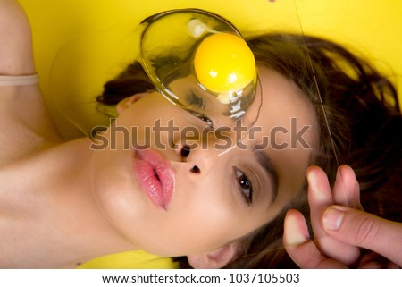 creative photo of egg over woman face< beautiful barbie face