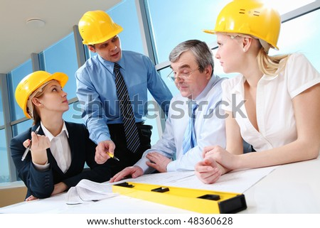 Creative photo of foreman speaking about near strategy to his business team