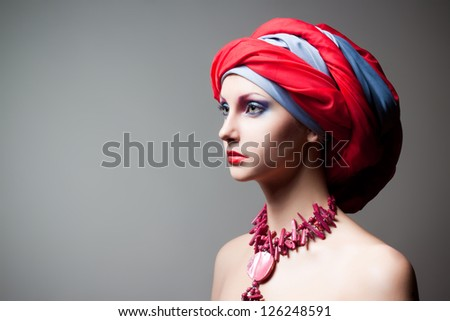 creative portrait of beautiful girl in a turban