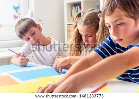 Creative projects with children at home or at school. Kids making some paper crafts.