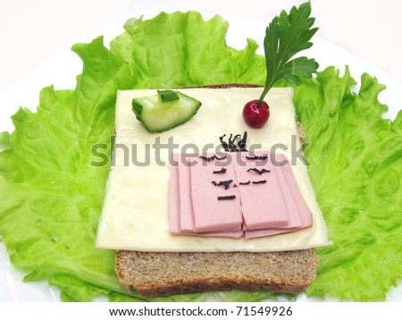 creative sandwich with cheese and book made of sausage
