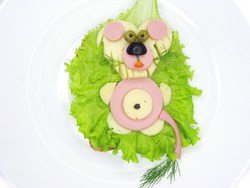 creative sandwich with cheese and ham lion made of salame