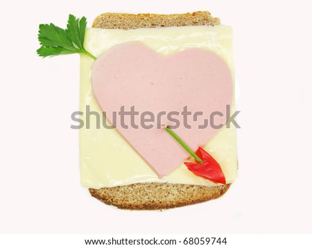 creative sandwich with cheese and heart made of ham
