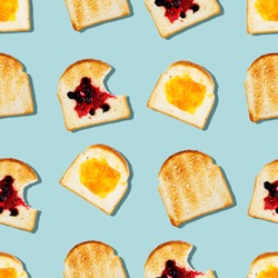 Creative seamless pattern or set of toasted bread with tasty different jam on light blue color background in pop-art style.Modern minimal food photography collage.Morning breakfast brunch concept